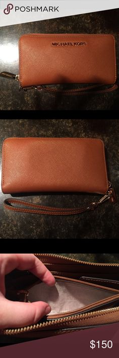 Michael Kors wrist wallet! AUTHENTIC GENTLY USED Very very gently used only one or two times, has wristlet attach that can be taken off as well.  Just like brand new! Very cute! Wouldn't ever get rid of it but I received a new wallet as a gift and don't want this to go to waste!! Michael Kors Bags Wallets