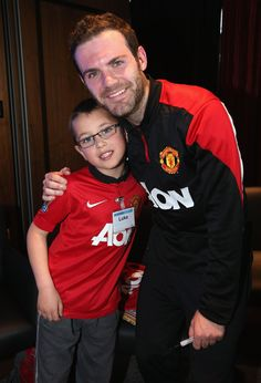 Spanish midfielder Juan Mata takes some time out to meet @manutd fans at the Aon Training Complex.