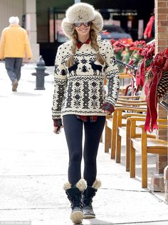 Hat trick: A smiling Elle Macpherson looked something like Heidi Of The Mountains in her huge furry trapper's hat, blonde plaits, and wacky ...