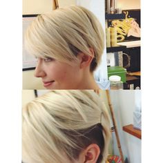 Short platinum hair with a side shave.