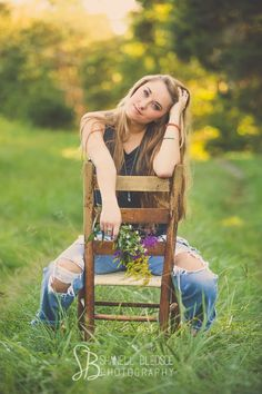 Casual, boho senior portraits outdoors with wildflowers.