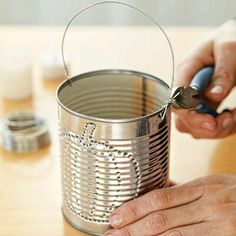 How to Create Tin-Can Lanterns how to make tin can luminaries adding handle to tin can luminary Aluminum Can Crafts, Tin Can Crafts, Diy Crafts, Home Crafts, Fall Crafts, Tin Can Art, Tin Art, Recycled Tin Cans, Recycled Crafts