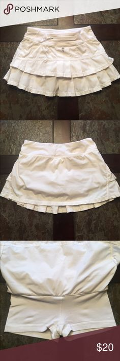 Ivivva Skirt White Iviva Tennis Skirt. Worn but still in good condition. Still bright white. Shorts underneath aren't as bright white. One small blue stain on back bottom right corner. View last picture for stain. Size 8! Ivivva Bottoms Skirts