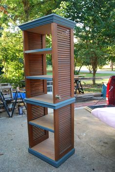 Linen Tower made from 2 louvered closet doors. Shelves made from Luan doors cut to fit.