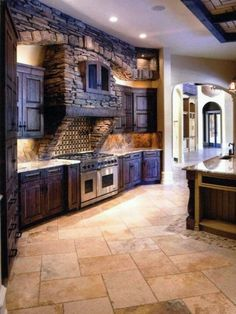 Great Stonework on kitchen range hood gives it a fun fairytale quality