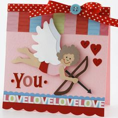 Piece a Cupid for a Cheerful Valentine  Design by Valerie Salmon  Valerie designed this cute cupid for her Valentine's Day card. She paired a colorful polka dot ribbon with a blue button to accent the patterned paper running along the top of the card. She embellished the card with cheerful red gems to add dimension.  Editor's Tip: To create contrast between cupid's wings, use two different colors of cardstock. When placed together, they stand out against the background better.
