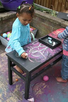 DIY chalkboard table- would be so fun outside and much more comfortable than being down on the drive or walk way....