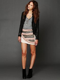 An embellished skirt with a leather jacket and booties is a cool, hip, and fresh combination perfect for a concert or bar hopping.