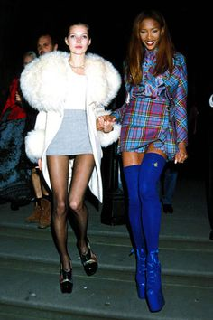 1991: Kate Moos & Naomi Campbell wear mini skirts
