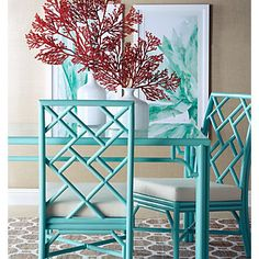 Deep coral centerpieces put the finishing touch on an aquamarine dining set.