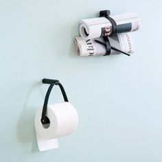 Scandinavian designed toilet paper holders in leather and black oak wood by By Wirth, Denmark.