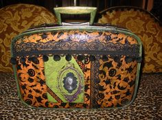 Recycled HALLOWEEN Gothic Vintage suitcase by  C. Reinke with holograph portraits. $75.00, via Etsy.