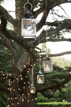 Hanging lanterns & twinkle lights for a whimsical atmosphere. Love it!
