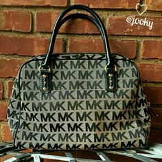 """Michael Kors signature dome satchel gorgeous MK large dome satchel in MK signature khaki/brown print with black leather. NWT. comes with detachable black crossbody strap. very roomy & comfy to wear or hold. no trades.  Canvas fabric gold hardware outer front pouch 4 inside pouch 1 inside zippered pouch height 11"""", bottom width 13.5"""" top open width 13.5"""" 21"""" crossbody strap drop, 5"""" attached strap drop Michael Kors Bags Satchels"""