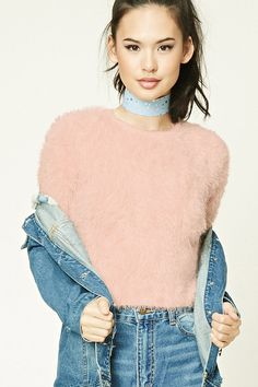 In a semi-cropped silhouette, this fuzzy faux mohair knit sweater features a round neckline, half sleeves, and ribbed trim.