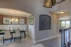 Completely integrating your palette into the light hardwood, baseboards, paint color, wall panels, and even artwork give your home a sophisticated look. Seen in The Highlands of Remuda Ranch, a San Antonio community.