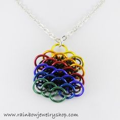 This pendant is woven with lightweight aluminum rings, and is about one inch in diameter. It hangs from a 20 inch chain, which can be adjusted to suit.
