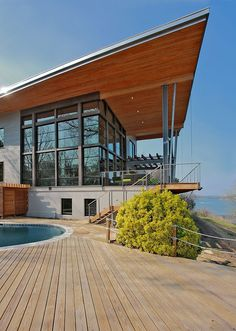 Heavenly Greenhouse Design with Wooden Deck: Unique Shaped Outdoor Swimming Pool With Deck Pool Side