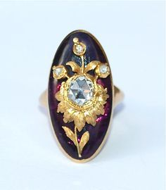 A fine quality ring, circa 1780, the tapering gold shank supporting an oval dome of cabochon amethyst glass set over cerise-pink foil and inlaid with a foiled rose-cut diamond and gold sunflower, symbolic of love and fidelity.