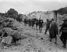 Line of 3rd Battalion, 5th Marine Regiment march, gear on their backs, through the hills at Peleliu. Oct. 1944