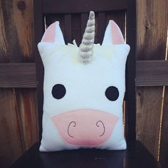 This one of a kind unicorn pillow is entirely handmade from top quality, super soft fleece, wool felt, allergen free fiber fill, and sparkly fabric. All details are securely machine stitched on making this item safe for all ages. Perfect for decorating and snuggling. Approximately 14in x 12 inches not including ears and horn **Due to an overwhelming response to my new line of pillows current production time on all orders is 4-6 weeks. Shipping time is in addition to that. I do apologize…