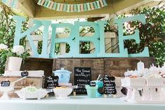 Vintage Puppy Birthday Party - how adorable is the spray painted dog bone banner?!