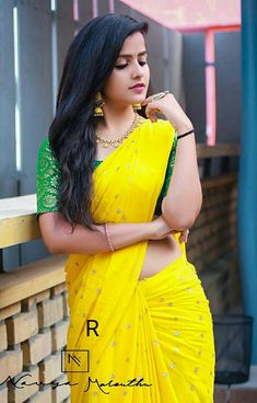 In a yellow color saree and contrast green color elbow length sleeve blouse design Beautiful Girl In India, Beautiful Blonde Girl, Beautiful Girl Photo, Beautiful Saree, Beautiful Women, Beautiful Bollywood Actress, Most Beautiful Indian Actress, Beauty Full Girl, Beauty Women