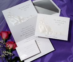 Item T1965  A beautiful pearl Bible graces the front of this bright white invitation surrounded by roses. Your favorite verse or Bible quote is featured on the front and your names show through on the bottom.