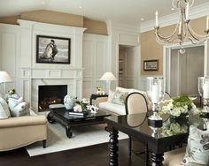 The white paneling on the outside of the fireplace, great room opening look
