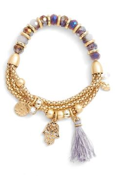 Free shipping and returns on Lonna & Lilly Beaded Stretch Bracelet at Nordstrom.com. Eclectic charms and a colored tassel swing from this playful stretch bracelet. Pretty beads decorate one half while three metallic strands make up the other.