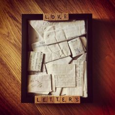 """""""I used a shadow box to hold the letters that my boyfriend and I wrote to each other in high school. Also used some wooden scrabble tiles that I bought online to """"title"""" the display . Super easy to do!!"""" This Is Literally The Sweetest Thing Ever And I Would Do Something Like This Because I Love Arts And Crafts Stuff Lol."""