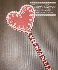 January 13, 2012  Valentine's Pencil Topper    Today I'm back to show you another one of my Valentine's Day creations.  Besides treats, my kids also like giving pencils to their classmates.  Rather than make cards and tape the pencils to them, I thought I'd make the pencil into a Valentine.    Pencil Topper Front    Here's a look at the front of the pencil topper.  The scalloped heart is from the Scalloped Heart of Hearts Embosslit die.  I stamped the heart image and then punched it out…