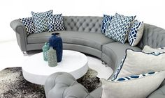 Relax in luxury on this beautiful circle sectional which is finished in smooth grey leather, rolled arms, tufted back, down wrapped cushions and stunning turned lucite legs. Sounds like perfection for