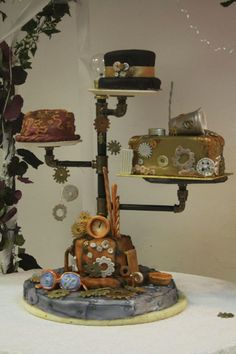 this is the idea with different cakeson that stand. The bottom would be a real vintage suitcase instead.