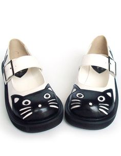 Cute little girl shoes w/ black cats at the toe.