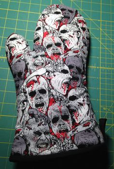 Amazing zombie oven mitt on Etsy! Follow the link to see the blood spattered lining!  https://www.etsy.com/listing/203779278/oven-mitt-zombies