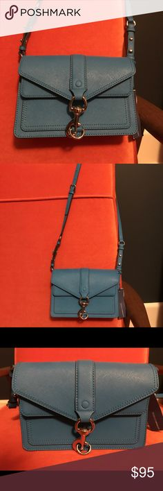 """NWT Bright Blue Rebecca Minkoff Crossbody Bag Brand new/never used with tags this Hudson Moto Mini Bag in luxe saffiano leather is a fun and functional addition to any wardrobe! Features hidden magnetic closures and shiny silver metal hardware. Includes two interior compartments, one interior slip pocket, and one exterior flap pocket.  It's the perfect size and will add a fun pop of color to your winter wardrobe!  Measurements: 8.5"""" W x 5.5"""" H x 3"""" D  20"""" strap drop Rebecca Minkoff Bags…"""