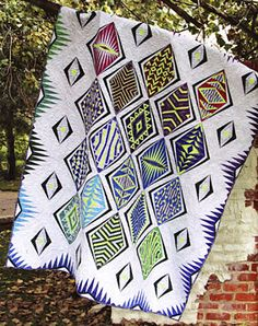 Empire Place quilt sewing pattern from Sassafras Lane Designs Empire Place is a contemporary paper-pieced quilt inspired by the amazing Art Deco era.