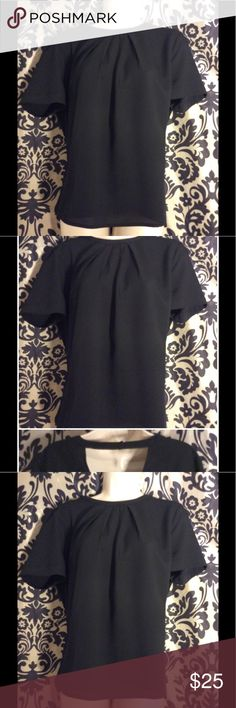 """Banana Republic Black Crewneck S/S Blouse This sophisticated and versatile Banana Republic Black Crewneck Short Sleeve Blouse with Tie Detail around the neck is lightweight and perfect for the spring and summer. The back of the shirt also features a wrap detail for style and sophistication.Can be worn casually or dressed up for work or a night on the town. Dimensions-Pit to Pit: approximately 16"""". Excellent Pre-Owned Condition.  No observable imperfections. Thank you for visiting my…"""