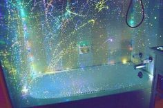 This glow in the dark shower curtain is awesome, inexpensive and easy to make! Simply, buy a clear shower curtain and throwglow paint on it!