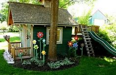 tons of fun playhouse ideas on this site. What about ladder and slide with guard around trampoline