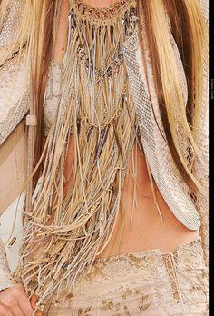 """Metallic Autumn  Hand-woven fabrics, grained and nubby fabrics, mixtures, metallics, lames, brocades, tweeds, tassels, fringe, slave bracelets, Congo belts, metallic circlets, amber, sardonyx, jade, carnelian, golds, copper, oxidized gold."""