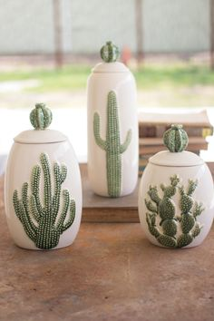 We're in love with these cactus cannisters. This set of three features a glazed ceramic stoneware vessel each with a different type of cactus adorned on the front of each container. Each lid is adorned with a cute little barrel cactus.