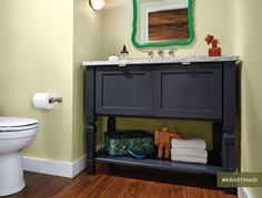 KraftMaid's console vanity for the bathroom looks like furniture and can be personalized with your choice of door styles, finishes and one of five leg options. (Shown in Midnight)