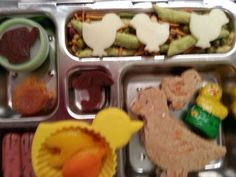 Duck PB's, chocolate duck, bell pepper umbrella and watering cans in a flower cup, turkey bunnies,  rainbow sunflower seeds,  fruit leather watering can and umbrella,  dried apricot tulips,  and Indian snack mix with cheese chicks