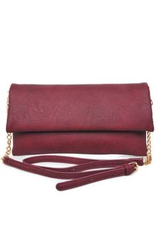 """The Socialite is the clutch that every collection needs. Ideal for the girl-on-the-go, this long, lean silhouette will work with every nighttime look, from jeans to your chicest little dress. Carry it in your hand, or use the detachable, adjustable strap. 12""""L x 2""""W x 7""""H   Urban Expressions Socialite by Urban Expressions. Bags - Clutches New York"""