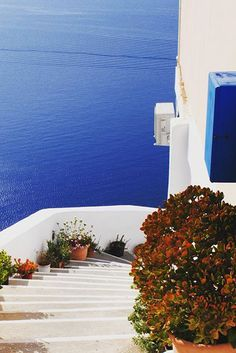 Santorini, Greece | Elegant white-faced villages sit seaside on the volcanic cliffs of this one-of-a-kind Mediterranean destination.