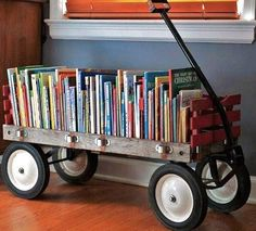 13 DIY Book Storage Solutions for Kids. I am now on the hunt for a vintage wagon to make for book storage! wish I still had our wagon! Deco Kids, Old Wagons, Home Libraries, Kid Spaces, Decorating On A Budget, Decorating Games, Interior Decorating, Toy Boxes, Kids Bedroom