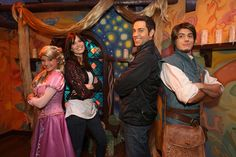 Actors Mandy Moore and Zachary Levi pose with characters Rapunzel and Flynn Rider, the characters they provide the voices for in Tangled.