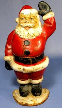 Hubley Cast Iron Santa Claus Door Stop: he is standing with his left arm up as if saying hello. Signed Hubley in larg. on Apr 2009 Vintage Santas, Vintage Dolls, Primitive Christmas, Vintage Christmas, Iron Holder, Christmas Figurines, Santa Ornaments, Iron Doors, Antique Decor